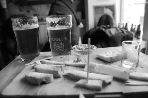 Cheese platter and IPA, compliments of Kaimiško Alaus Baras Šnekutis. Photograph by: Annastashia Goolsby