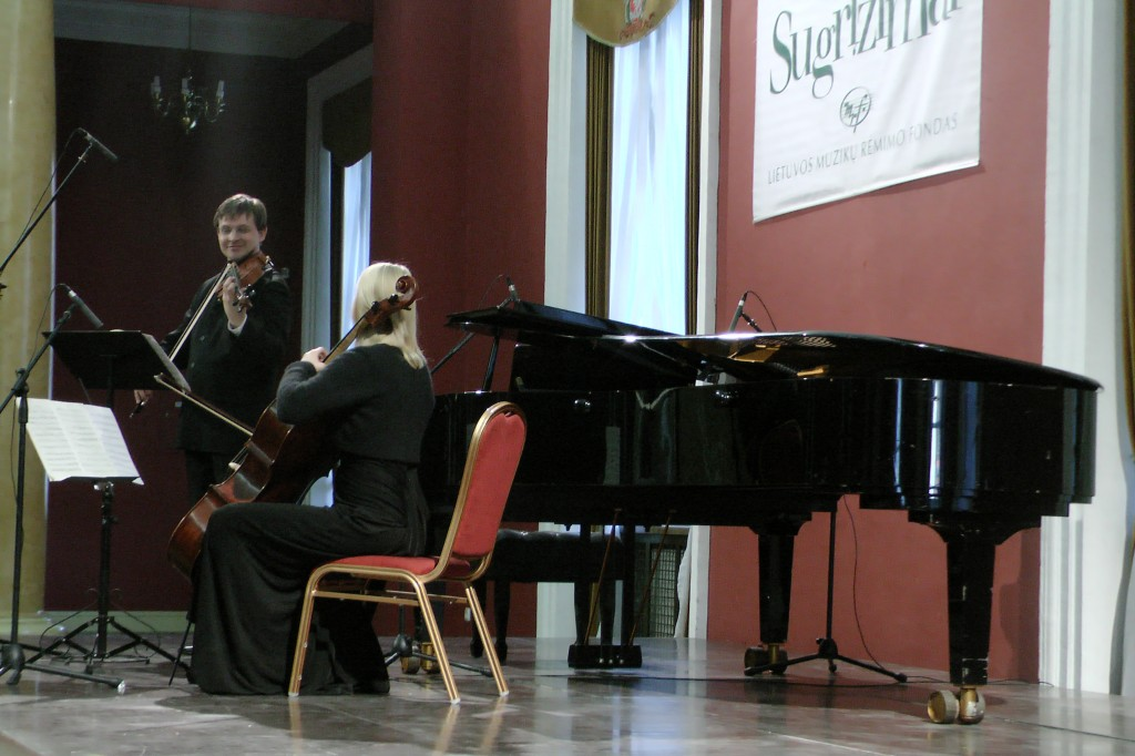 Lithuanian violinist Paul Syrrist-Gelgotos performing with his wife/colleague from Norway, Torril Syrrist-Gelgotos on cello at Vilnius town hall, moving the audience with their harmonies. Photograph by: Alexandria Molony